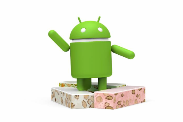 Android robot waving and standing on a pile of nougat
